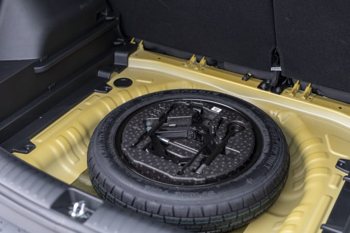 The S comes with a temporary spare wheel.