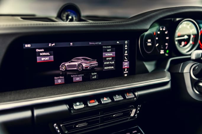 The dash is defined by strong horizontal lines with the central multimedia screen sitting above a broad centre console.