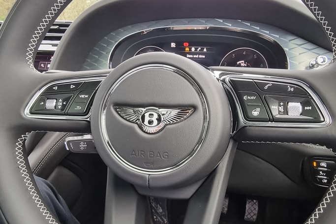 The steering wheel features no stitching on the outer rim to disrupt the touch of soft leather in your hands.