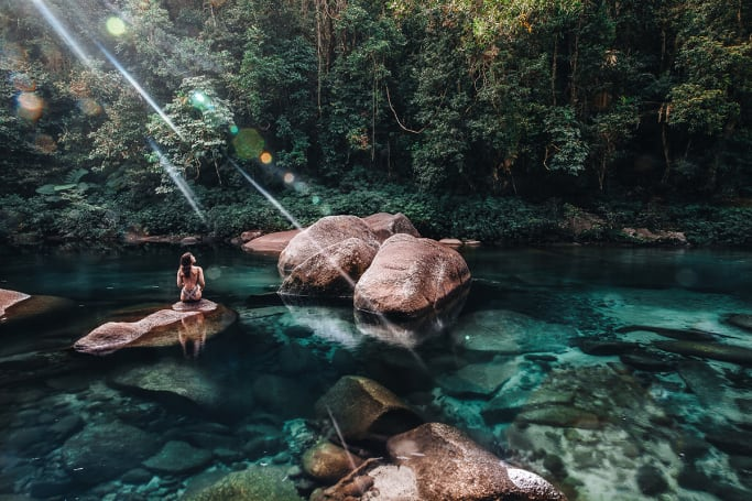 Camp walking distance from TNQ's best natural swimming hole at Babinda Boulders (Image credit: Tourism and Events Queensland).