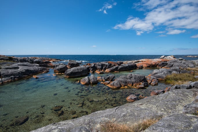 Who wouldn't want to camp next to water like this in the Bay of Fires.