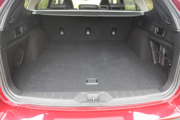 The cargo capacity of the Subaru Outback AWD Touring, with five seats in service, is 522 liters.