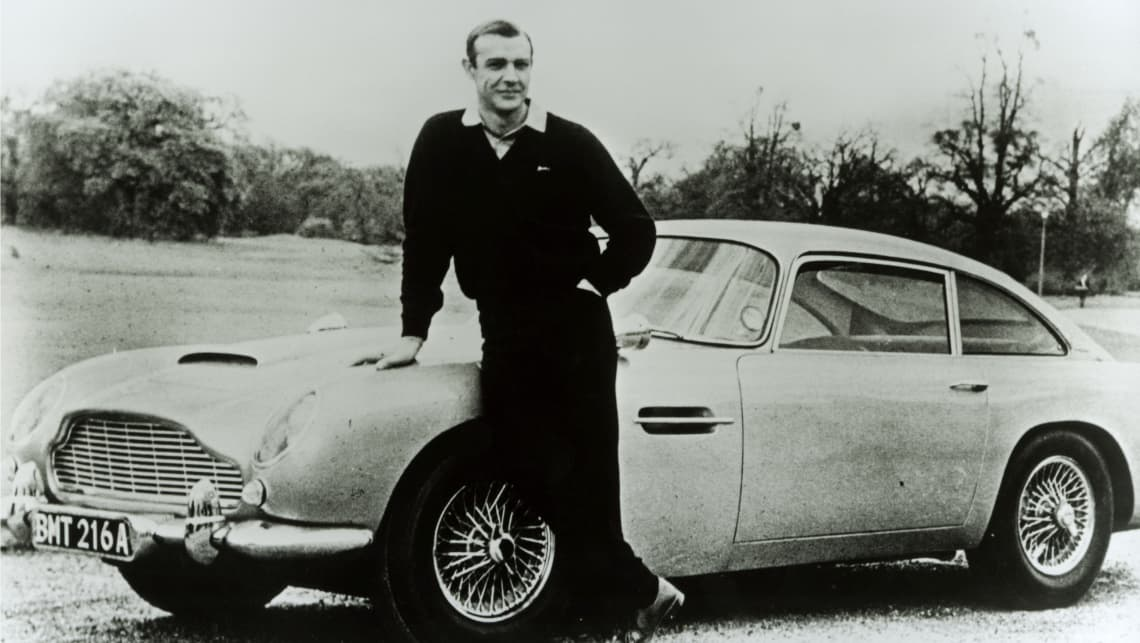 Sean Connery with the iconic Aston Martin DB5.
