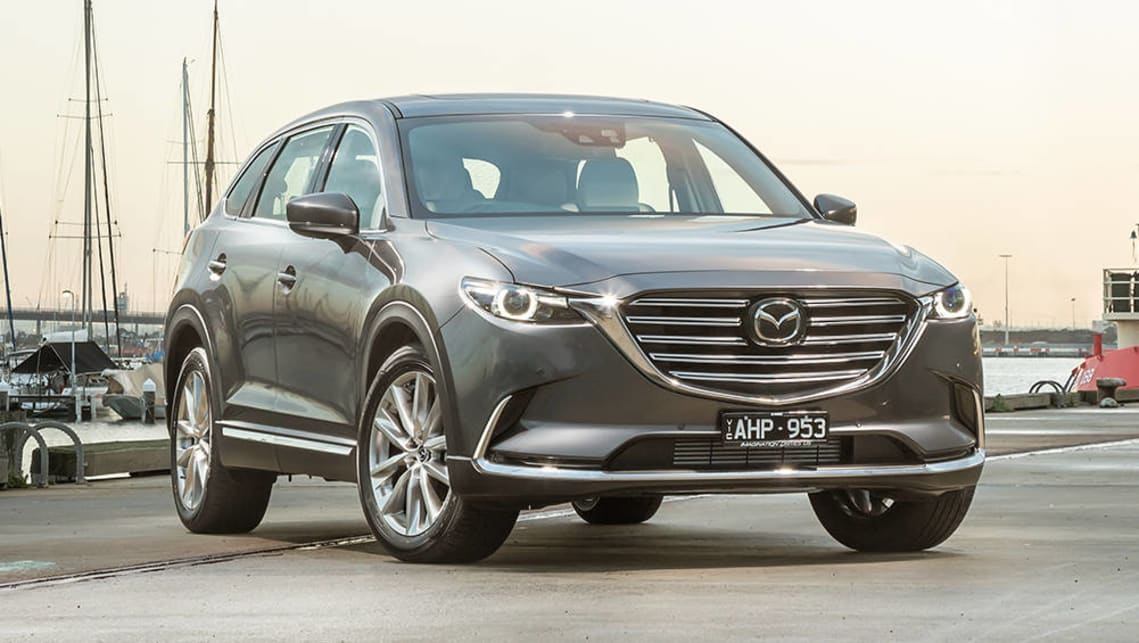 The current Mazda CX-9 should be able to accommodate three child seats across the back seat.