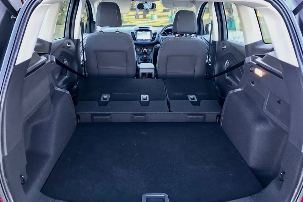 The 60/40 split fold rear seats drop but leave a step in the floor (image credit: Peter Anderson)