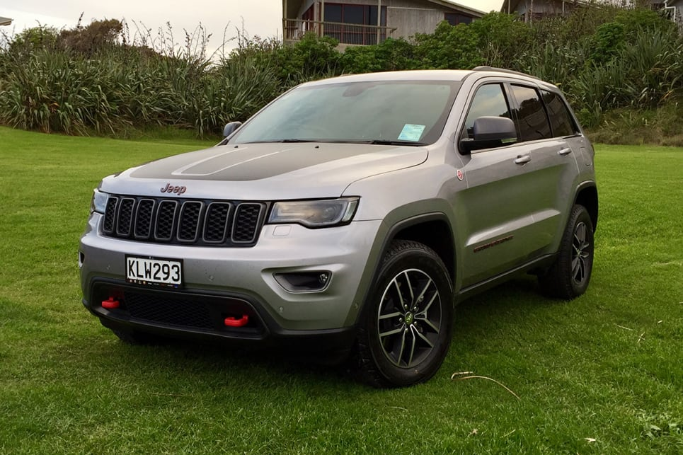 The new Trailhawk rivals the SRT for attention-seeking-but-still-functional bling, with its red tow hooks and badging. (Image credit: Richard Berry)