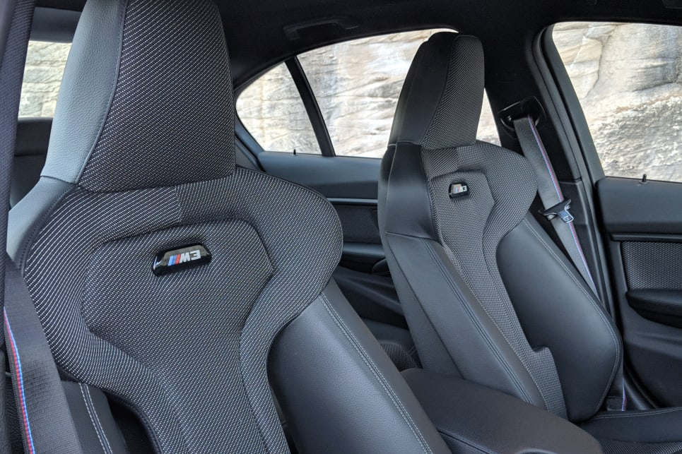 The M Sports front seats may be draped in cloth, but they look premium and provide a super snug fit.