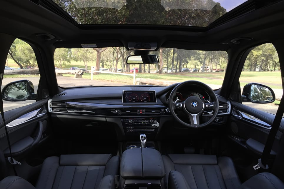 That large screen, the virtual instrument cluster, the familiar BMW slab-like dashboard, and the luxurious seating add up to a prestigious cockpit worthy of a primo SUV. (image: Richard Berry)