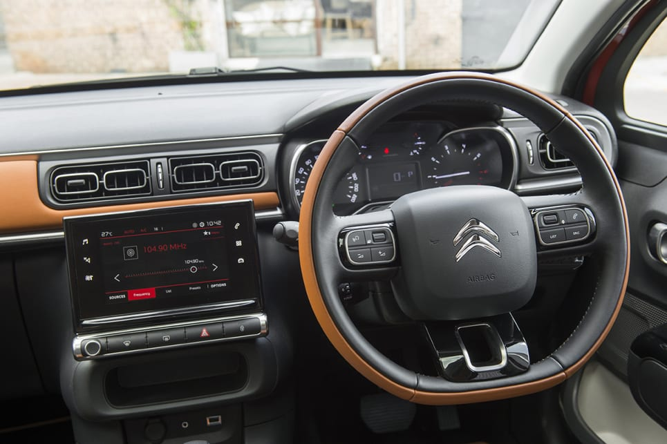 The Colorado Hype interior includes judicious use of a burnt orange leather on the steering wheel.