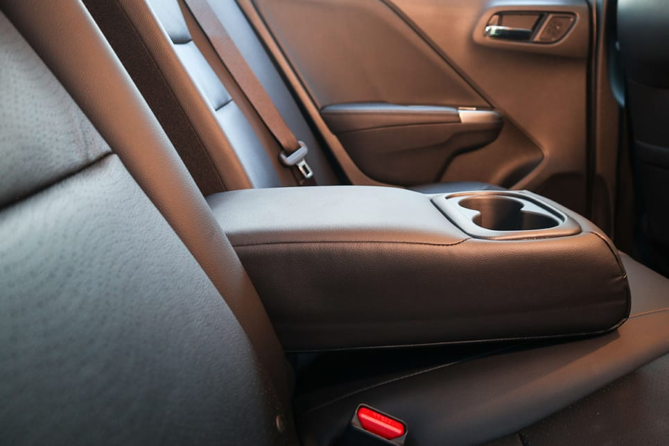 The VTi-L gets two more cupholders in the rear centre armrest. (image credit: Tim Robson)