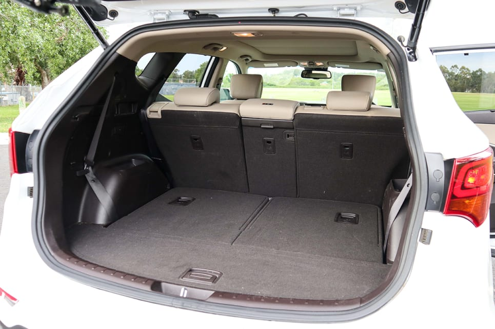The Santa Fe will take a full size bicycle without the wheels removed with the 40/20/20 split-fold seats folded flat into the floor. (2018 Hyundai Santa Fe Highlander model shown)