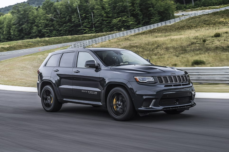 The body-coloured wheel arch flares and bonnet vents are shared with the SRT, but the Trackhawk gets its own set of massive 20x10-inch rims fitted with 295/45 ZR20 Pirelli tyres.