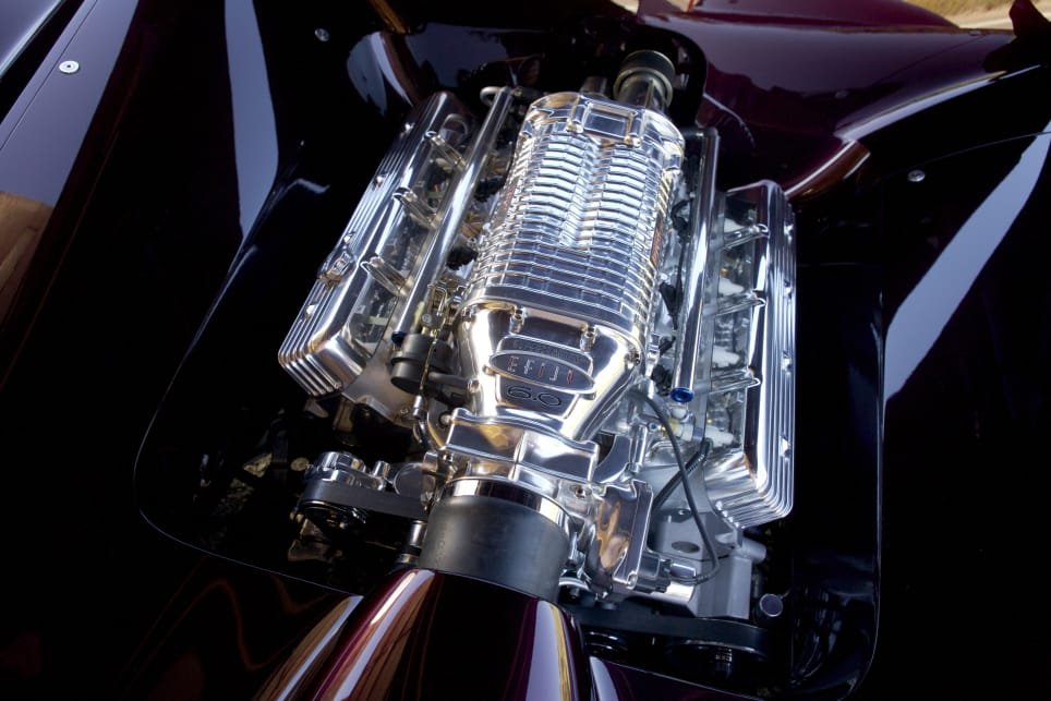 That's no fake engine cover, it's a fully-operational supercharged 6.0-litre LS2.