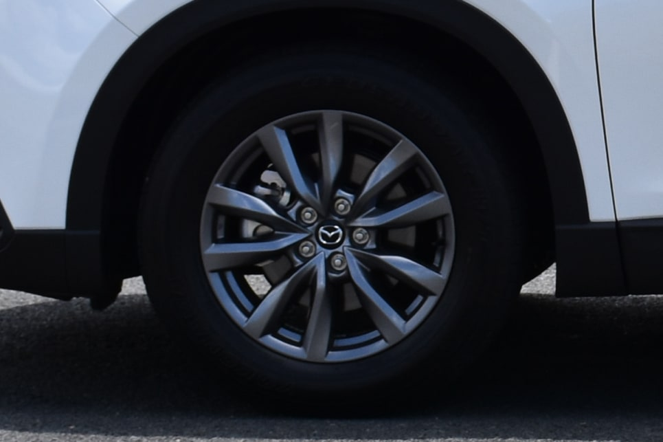 The Mazda's smoky-finish 18-inch wheels are attractive but a bit understated. (image credit: Thomas White)