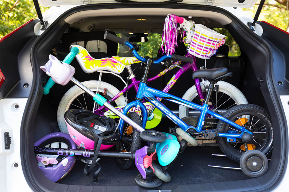 I could fit two kids bikes and two scooters into the boot.