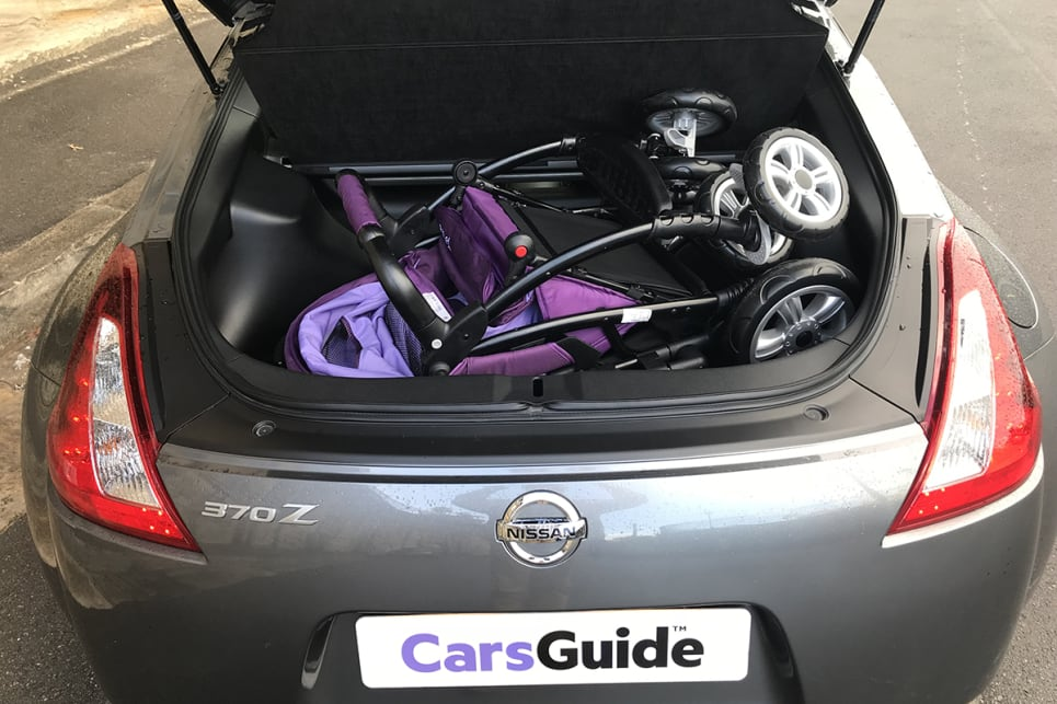We also had a crack at stuffing in the 'CarsGuide' pram and managed it with only a couple of beads of perspiration expended. (image: James Cleary)