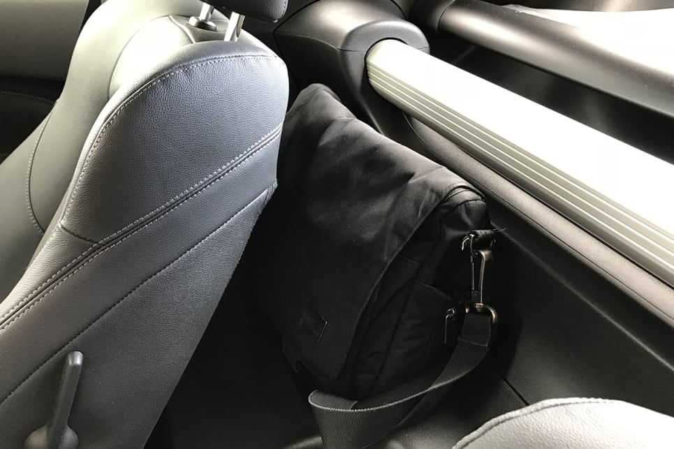 There are two lined recesses for soft bags or coats behind each seat. (image: James Cleary)