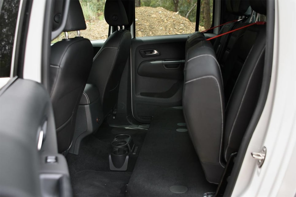Both have a pair of cupholders between the seats, and there are bottle holders in all four doors (the Amarok's are bigger, and lined to stop things rattling around).
