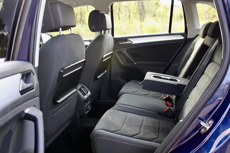 The Tiguan has a fold-down armrest with cupholders, bottle holders in all four doors. (image credit: Matt Campbell)