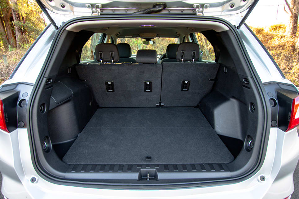 If you wish to fold down the rear seats, you'll need to remove the middle headrest in the Holden.
