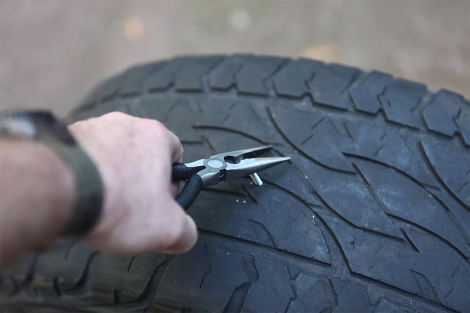 Find the puncture hole, get the offending object (stick etc) out of the hole with a pair of pliers.