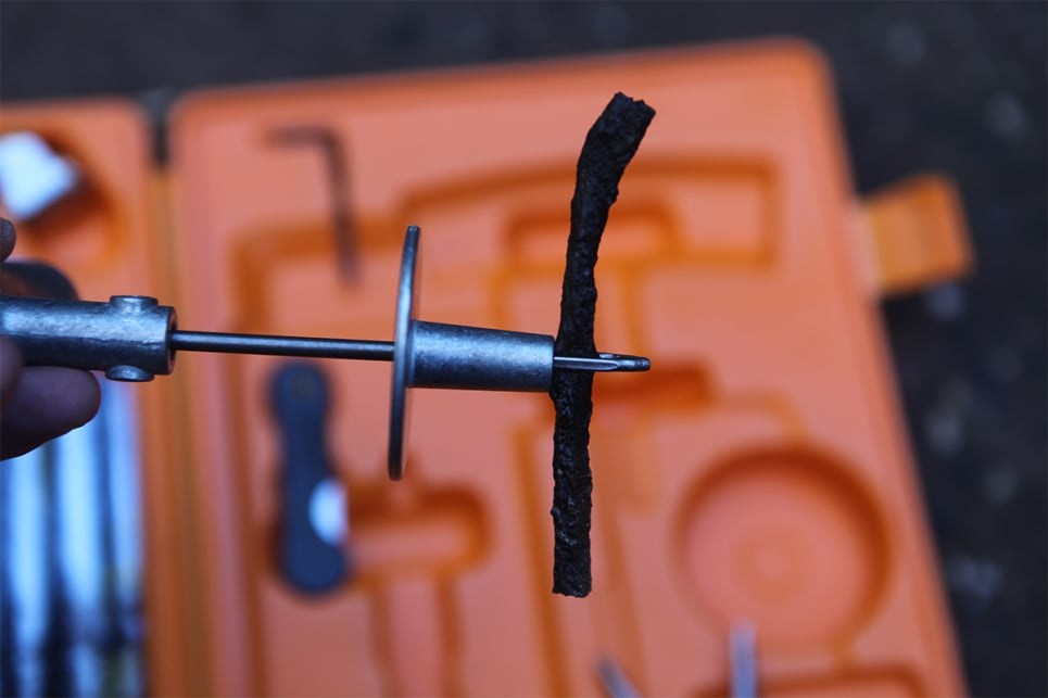 Thread a length of repair cord through the eye of the insertion tool.