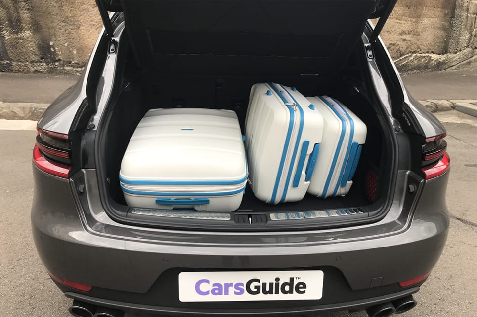 The boot has enough space to accommodate our three-piece hard suitcase set. (image credit: James Cleary)