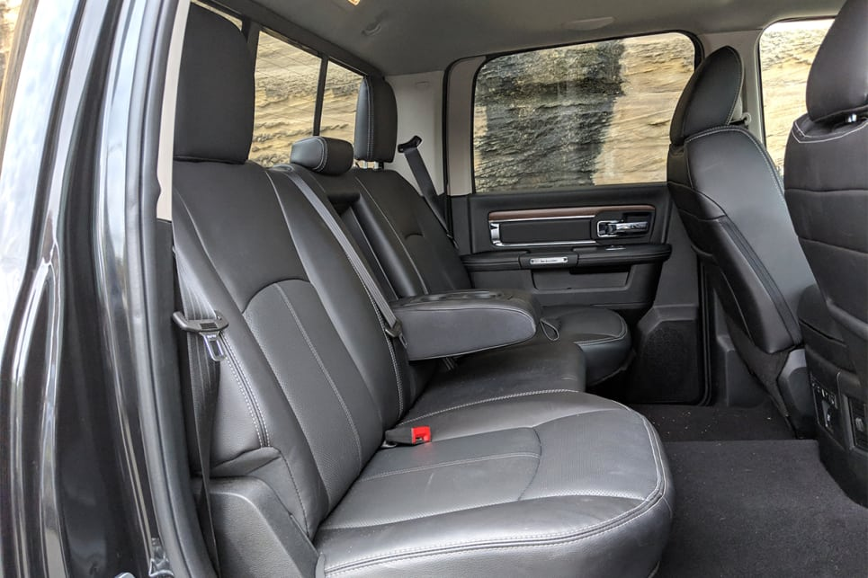 The backseat easily fits three large adults with inches of head and legroom to spare.