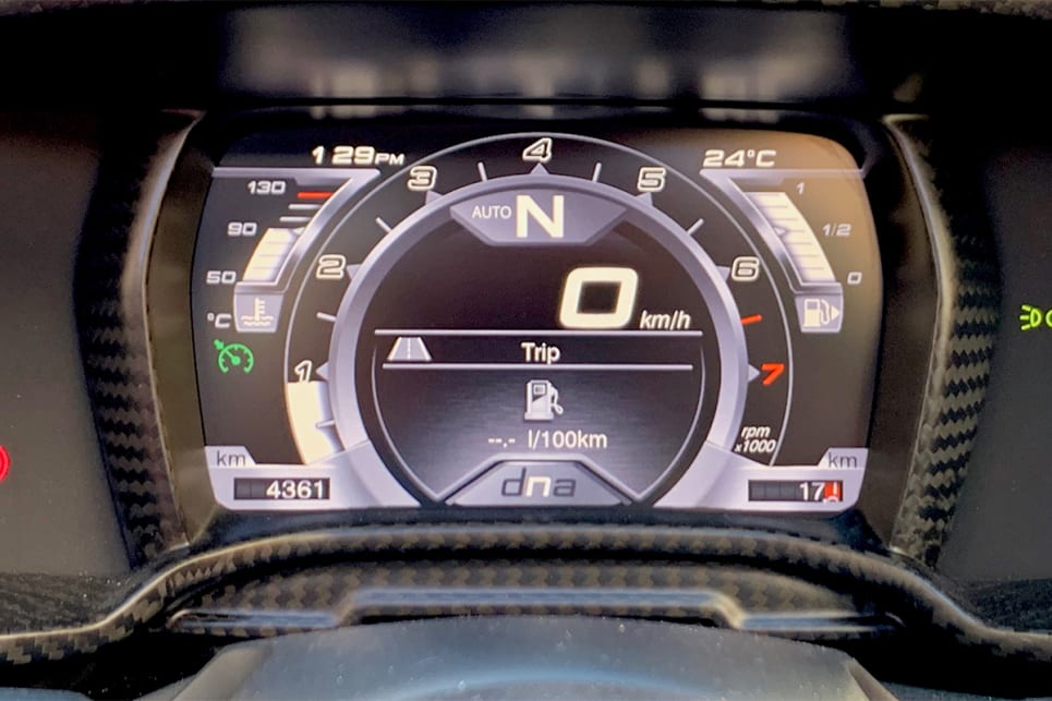 In front of the driver is a digital instrument cluster.