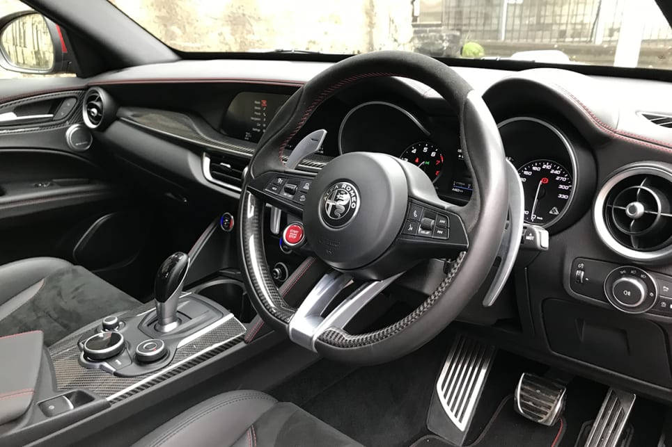 Features include a Quadrifoglio leather steering wheel with red starter button.