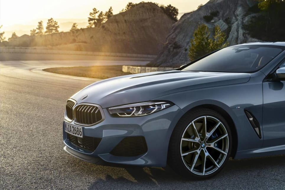 The M850i's bonnet is streaked with powerful lines and its spoiler scattered with carbon-fibre elements.