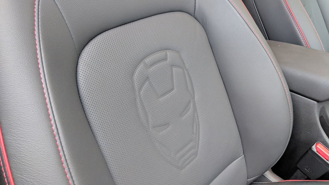 The front seats are embossed with the Stark Industries' logo.