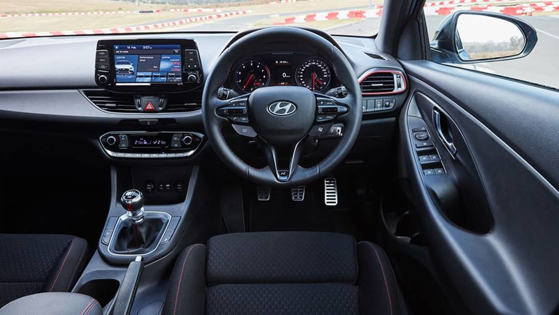 Inside there are alloy sports pedals, black headlining, red stitching (as opposed to blue in the hatch), sports front seats, and a leather-appointed steering wheel.