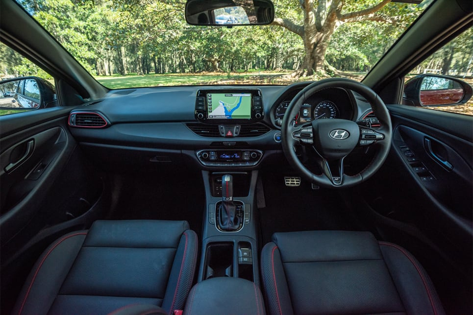 Inside, the i30 ups the sporty stakes with snazzy red seat belts and that red-metal trim around the air vents.