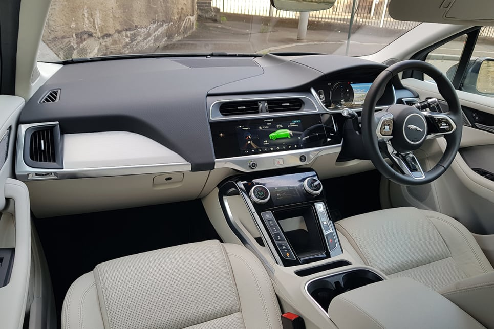 The inside is contemporary Jaguar, with surfaces and textures more aligned with the recent E-Pace.