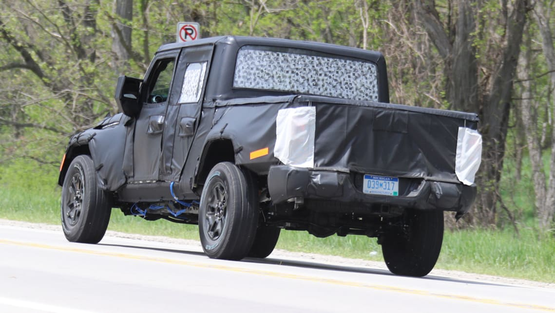 The pickup version of the Jeep Wrangler has been spied testing in Michigan ahead of its release in Australia next year.