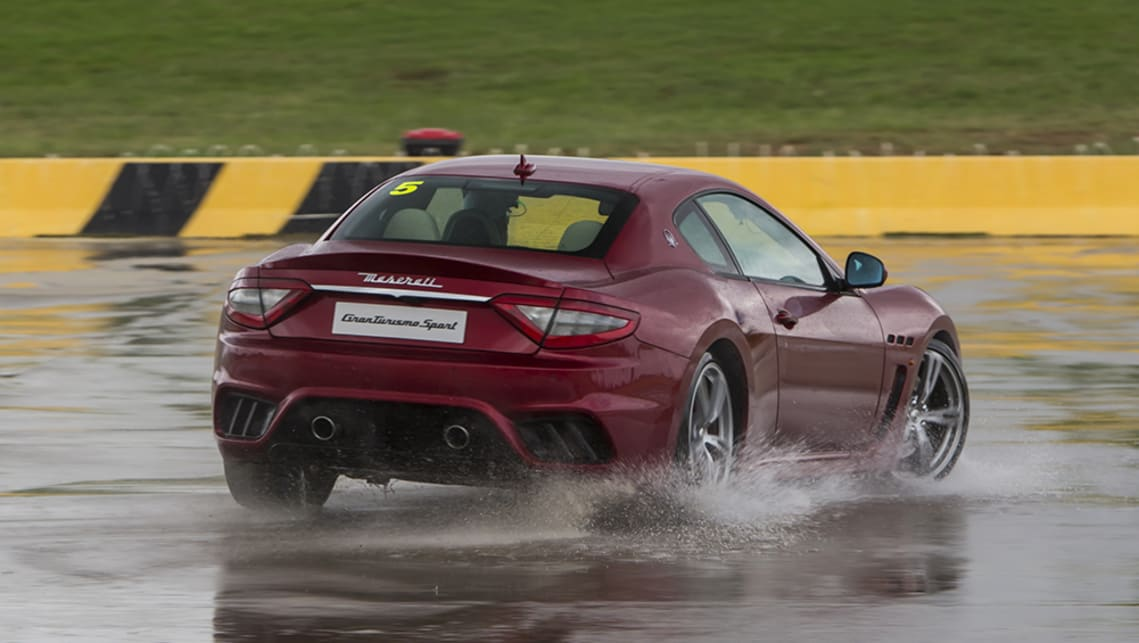 Drop it back to first though, and all 7500rpm worth of  the 4.7's old-school naturally aspirated linear power delivery makes it a joy to continually drift on the wet concrete.