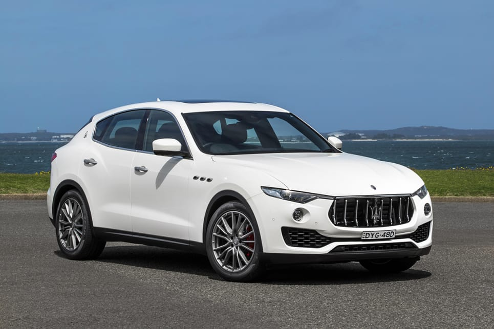 The Maserati's long bonnet is flanked by curvaceous wheel arches with their vents, leading towards a grille that looks ready to eat up slower cars.