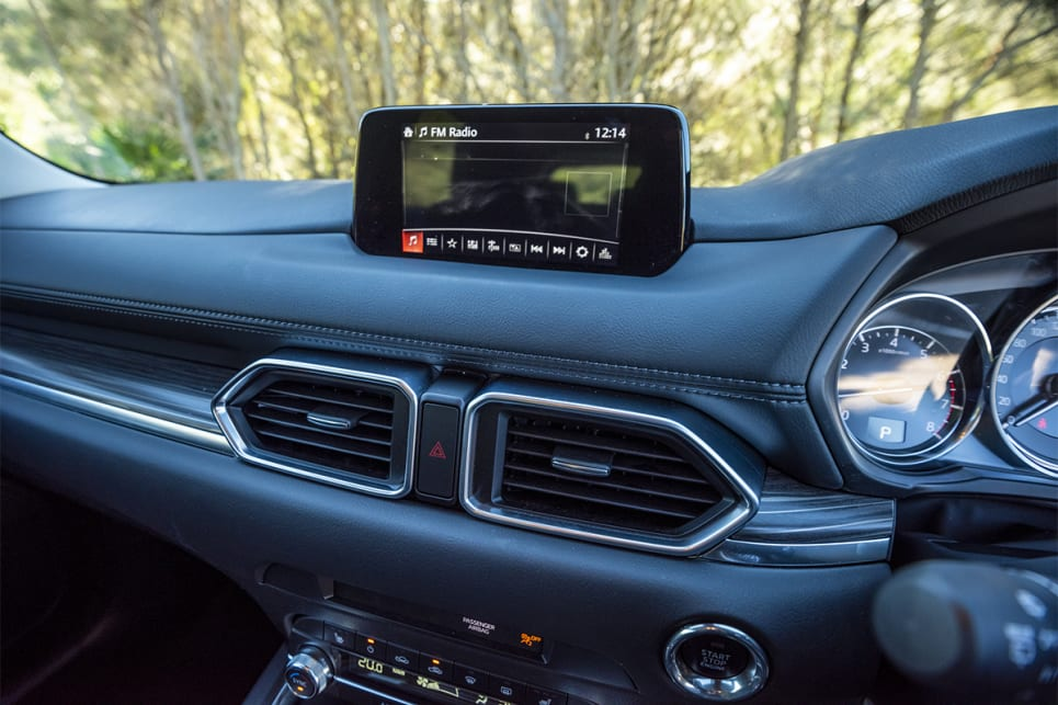 The Mazda's screen has the option of touch capacity at a standstill, or rotary dial at speed. (image credit: Dean Johnson)