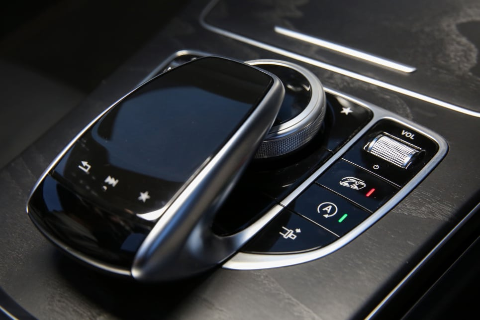 The multimedia system is controlled by a four-way rotating dial and touchpad.
