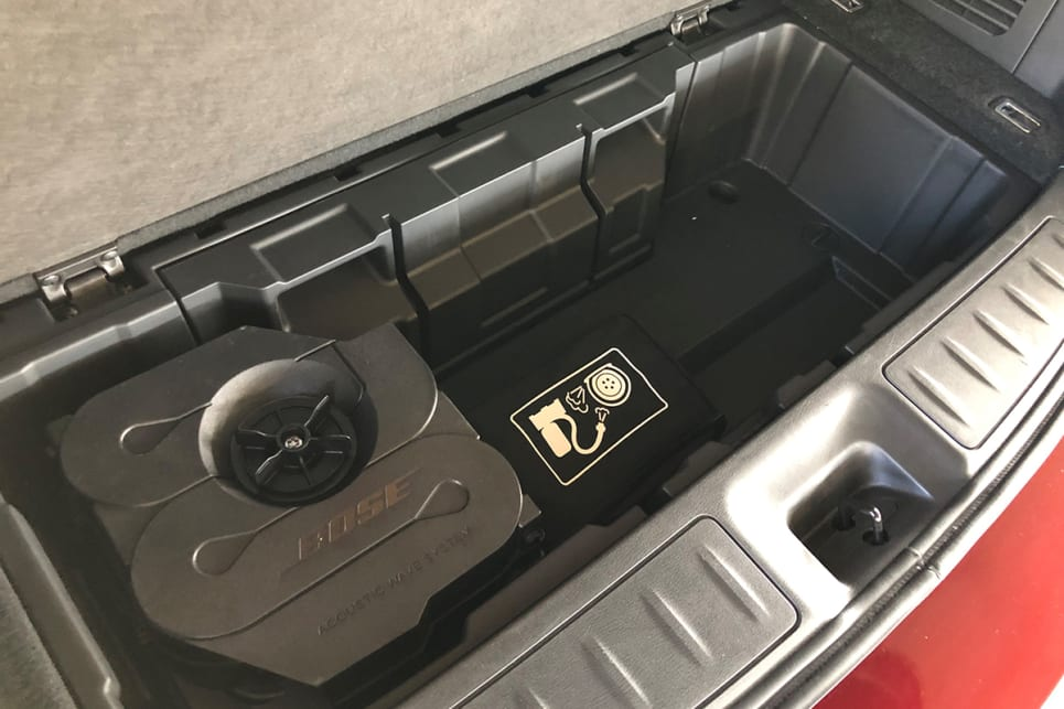Underneath the boot floor is the amp for the Bose sound system and the tyre inflation kit.
