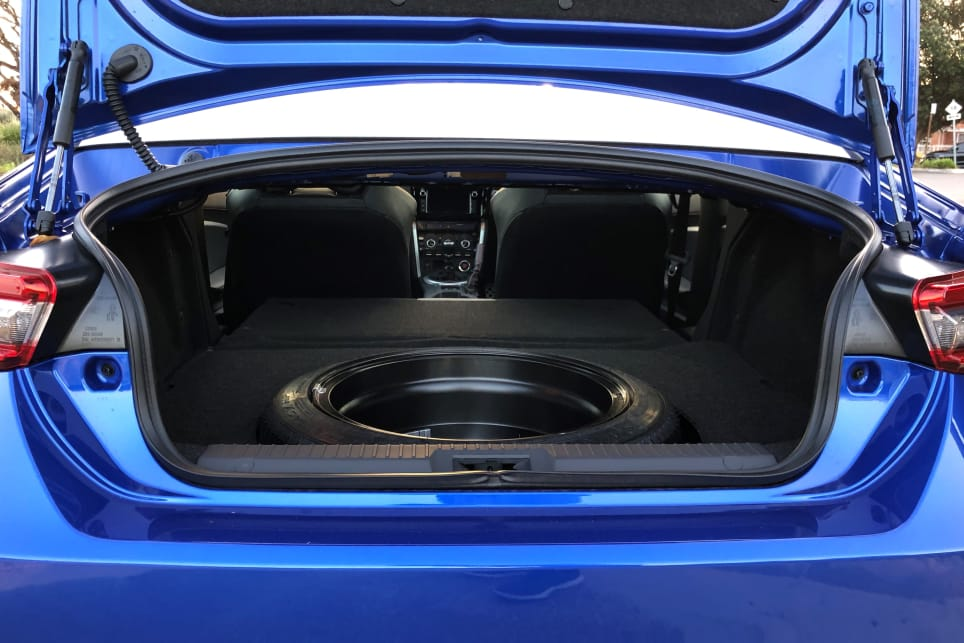 Boot capacity sits at just 218 litres. Drop the rear seat and there's space for a full set of alloys.