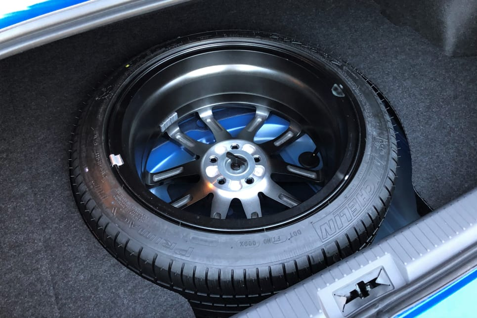 The boot in the BRZ is interrupted by the face-down full-size alloy spare.