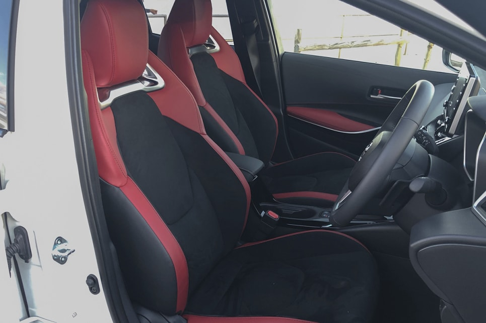 The cabin is lifted immeasurably by the excellent, racy front seats with the red inserts, Alcantara trim and metallic slots. (image: Peter Anderson)