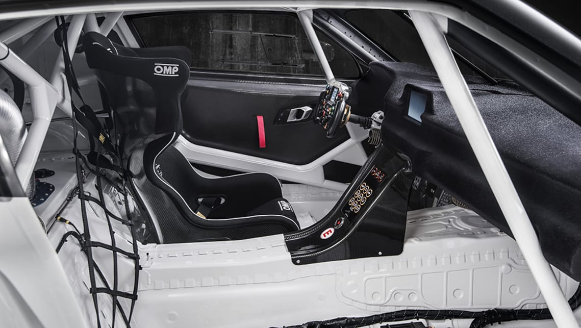 On the inside, a GT3-like roll cage, steering wheel and seat, along with exposed ancillaries like the ECU and fuel system mask very production-looking floor pressings.