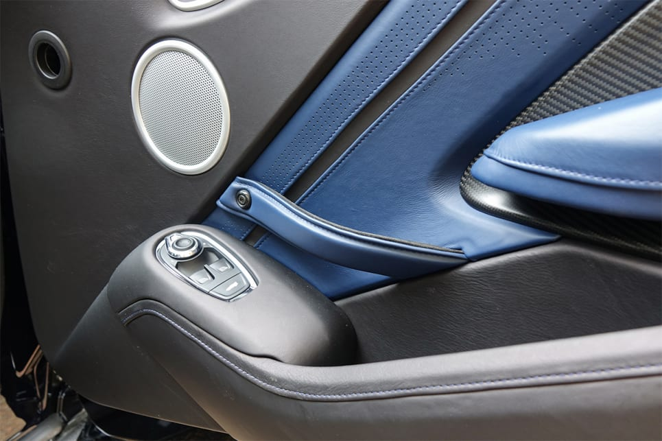 The blue and black leather continues onto the doors and there are also carbon fibre door inserts.