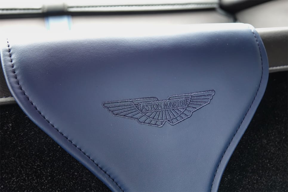 The Aston Martin logo is also embroidered.