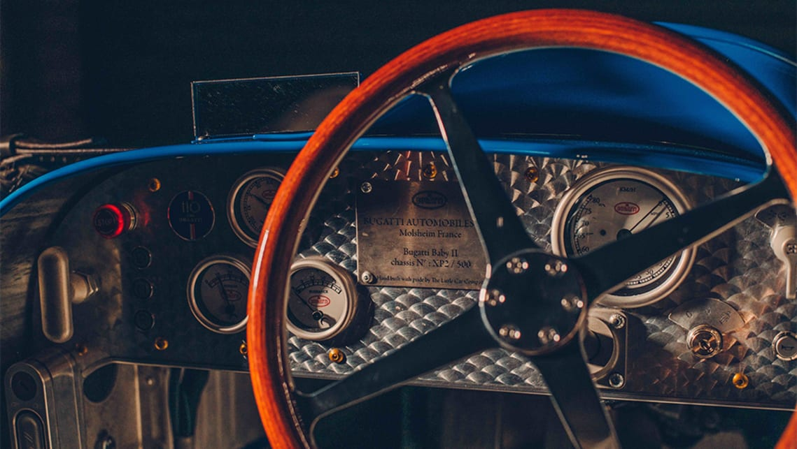 The distinctive four-spoke steering wheel is a scale recreation of that seen on the Type 35.