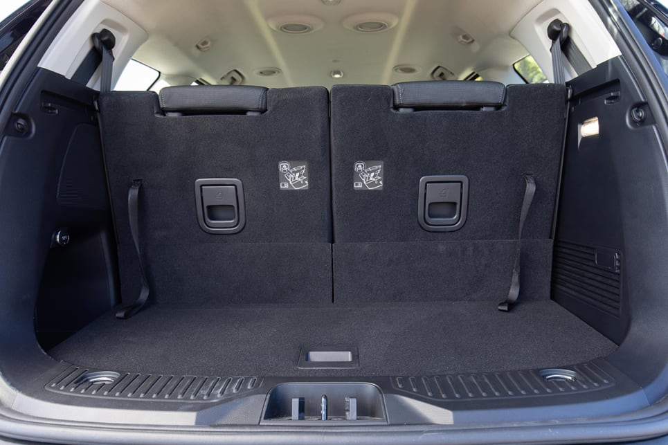 With that third row in use, the boot will fit a suitcase on the side, or groceries, or school bags. (image: Dean McCartney)