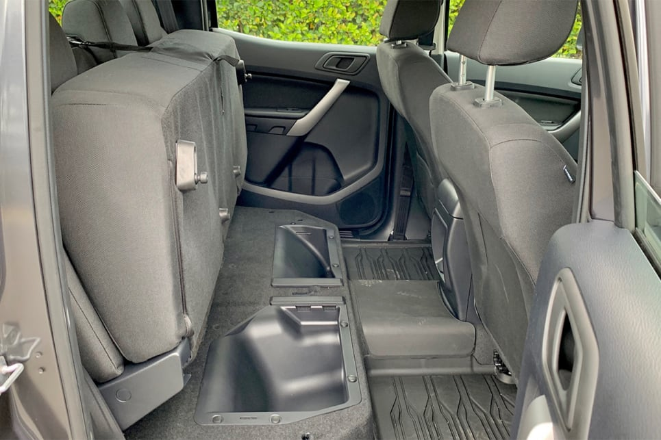 The rear seat base can be folded up to allow for additional secure dry storage.